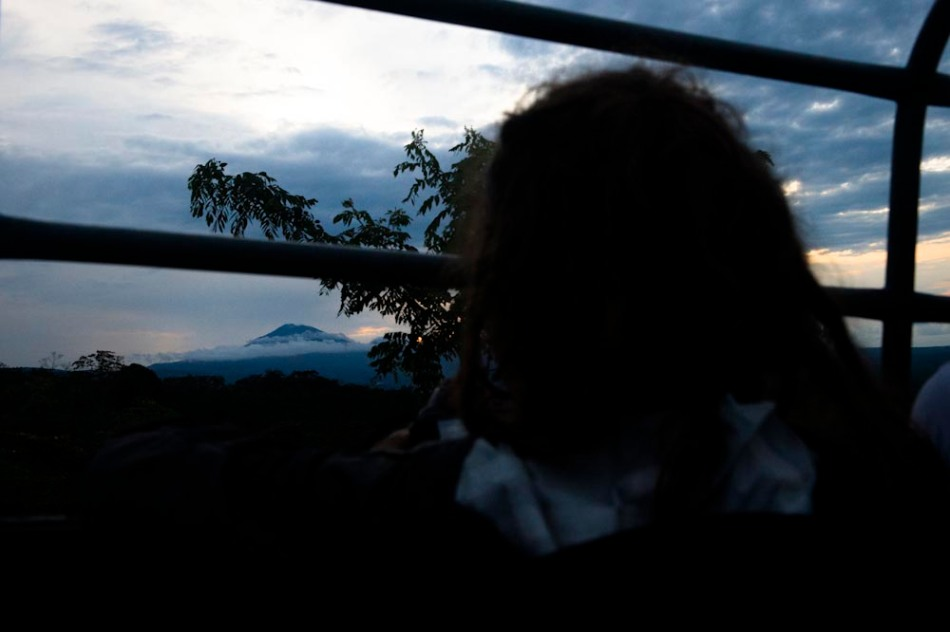 Sara looks out at the volcano at sunset