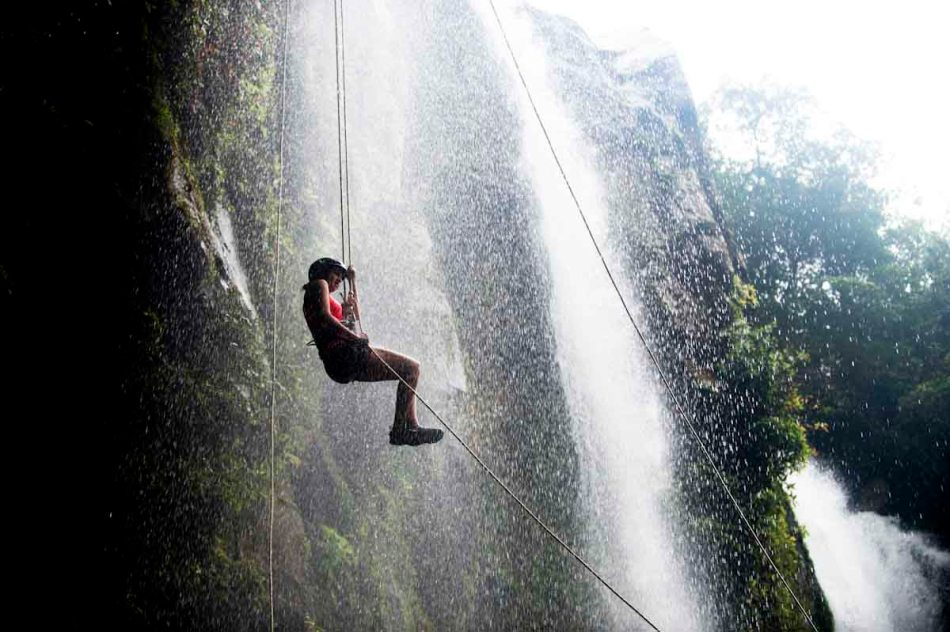 Sylvia rappels down a waterfall near Uvita, Costa Rica.