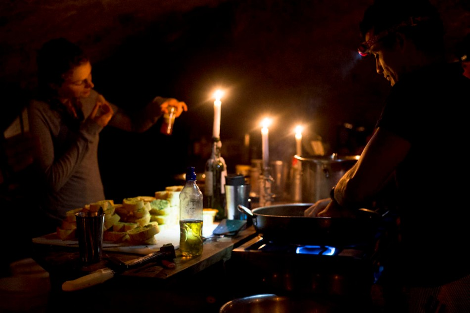 Our wonderful guides prepare a delicious vegetarian dinner by candlelight under Diamante Falls.