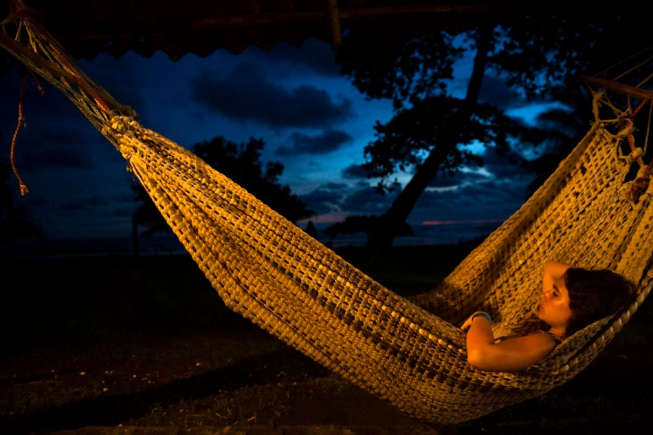 Mercedes relaxes in a hammock right after sunset.