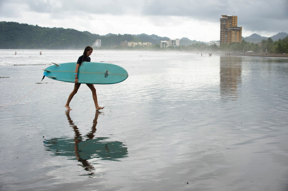 Bridget walks back to the group following an afternoon of surfing in Jaco.