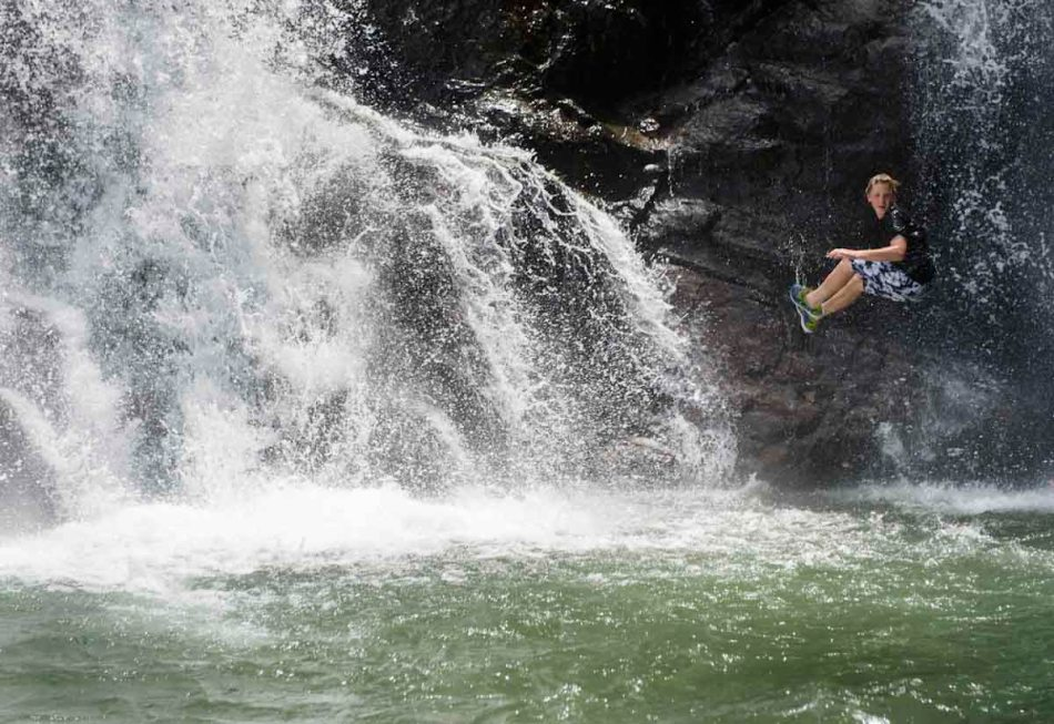 Sergei jumps off a waterfall during a break in our rafting trip.