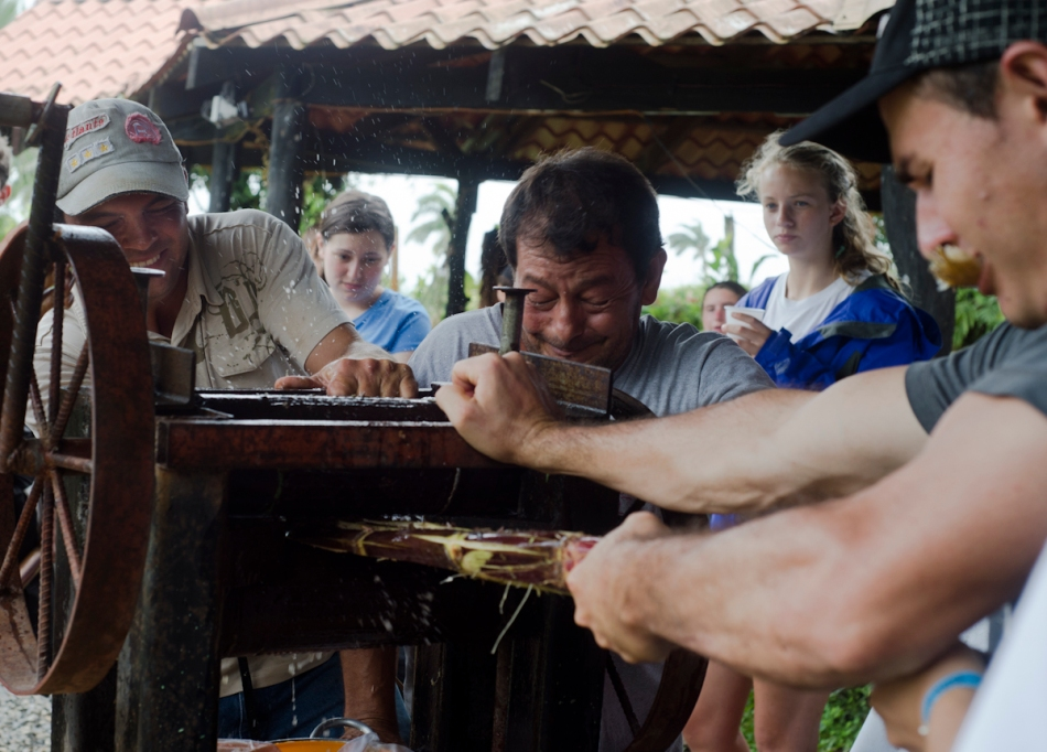 Everyone learned how to press sugar cane to make cane juice and tried a glass of it.