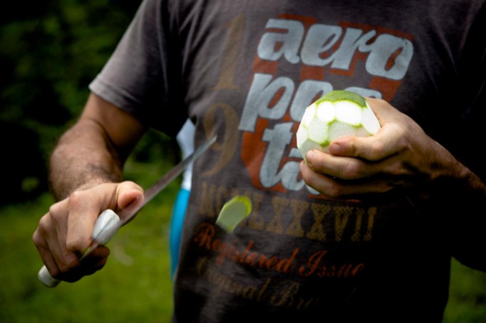 Edgar peels some oranges during a work and snack break in San Ramon.