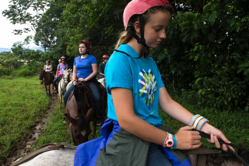 Bridget leads her horse during a morning trail ride.